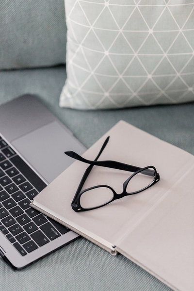 laptop, journal and glasses