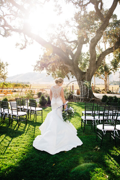 Bride near arch with black and white details at Gilroy Property