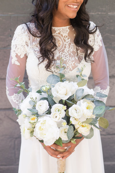 A bride poses with her DIY bridal bouquet at her downtown Sacramento wedding.