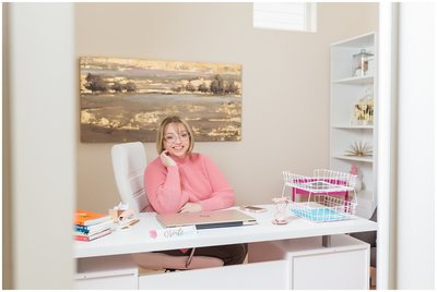 Laura Lee in home office with white desk and white chair