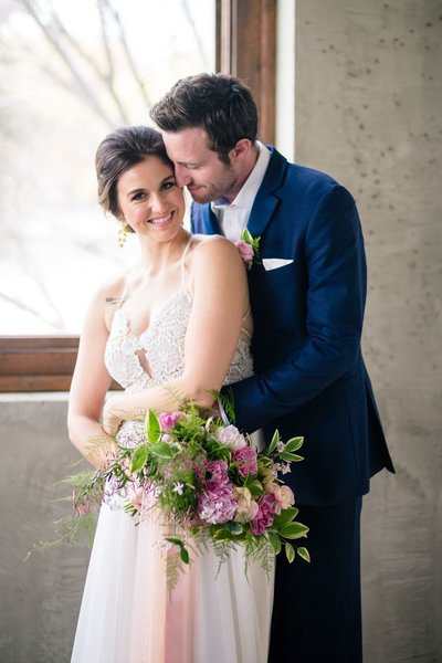 Atlanta wedding photographer Mike Glatzer portrait of bride and groom snuggling Summerour Studio