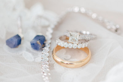 Detail shot of wedding rings and wedding day jewelry