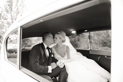bride and groom in a vintage car on the way to their wedding ceremony at Holy Spirit Catholic Church in Las Vegas
