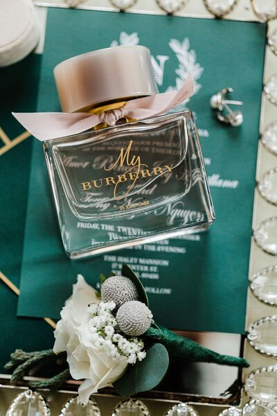 wedding invitations details with bottle of perfumes