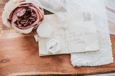 Knoxville Wedding Photographer | Ring box on letters and surrounded by roses