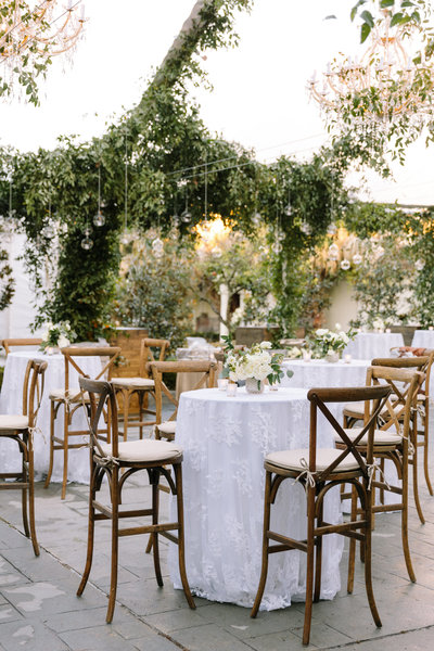 Elyse Jennings Weddings tented reception with greenery and thousands of hanging candles