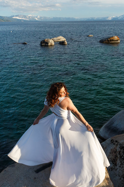 A bride twirling her dress at Lake Tahoe.