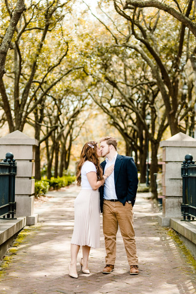 couple kissing in downtown charleston engagement session