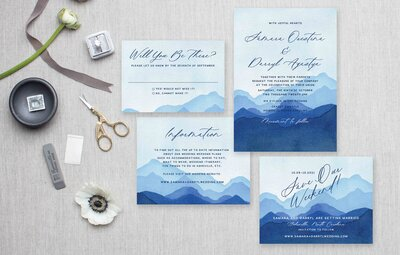 Blue watercolor mountain painted invitation suite