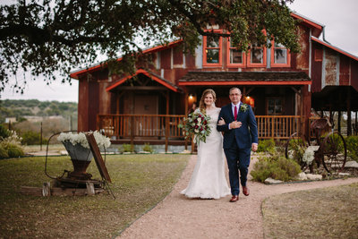 father and daughter walking down the aisle for an outdoor wedding near San Antonio