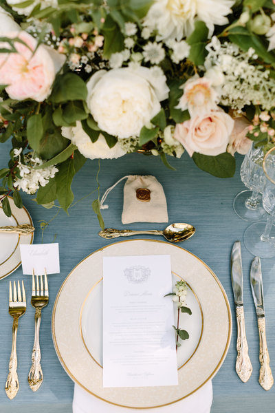 A small wedding at home on a bluestone patio with a blue and rose color palette by top destination wedding planner Always Yours Events