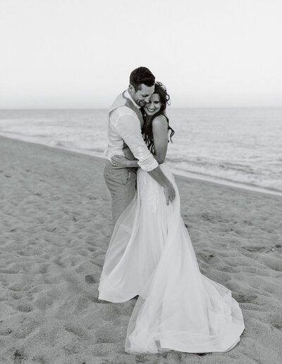 bride and groom together on a beach