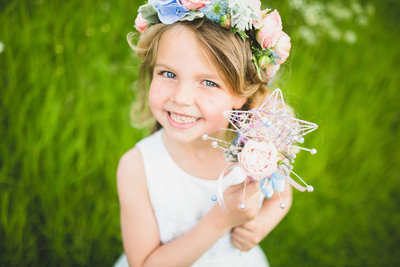 flower girl with floral bouquet and wand
