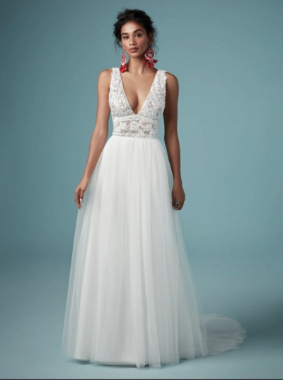 Boho A-Line Wedding Dress.  Looking to show off your shoulders and collarbones? This boho A-line wedding dress features a plunging V-neckline and lacy straps to help you do just that.