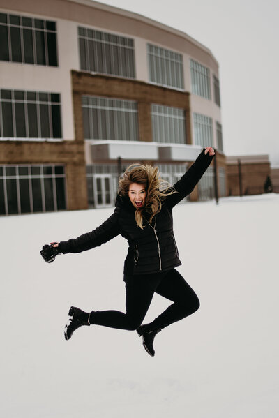 J.Michelle Photography jumps in the snow in oakwood, georgia