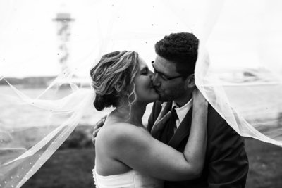 Erie, PA bride and groom kiss during portraits outside the Concourse at Union Station