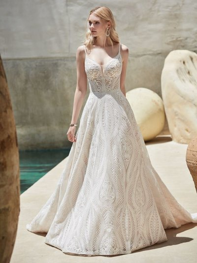A-Line Wedding Dress. Considering an enchanted forest for your venue? Consider gowns of the breezy boho persuasion, featuring sheer details, sensual lines, and the perfect pockets.