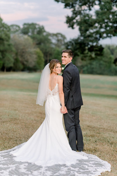 North carolina wedding photographer, bride and groom snuggling