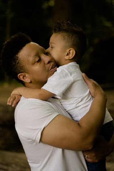 A father and son hug at Ijams Nature Center.