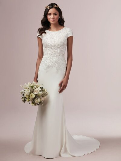 Modest Sheath Wedding Dress Favorite Add a dose of formal elegance to a relaxed silhouette with delicate lace motifs and smart tailoring. We have this modest sheath wedding dress in lovely crepe for your consideration.