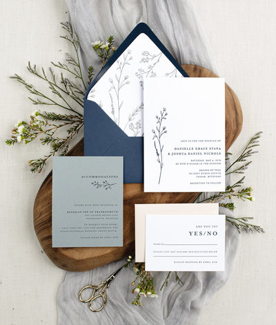 Simple. Classy. Modern. Three words to describe our Modern Wildflower wedding invitation. It features a lovely illustration of wildflowers on the left-hand side and minimalist, clean type on the right.
