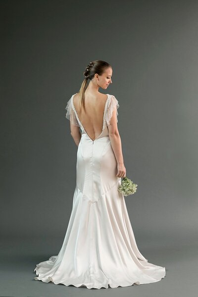 Back view of the Hana wedding dress in silver charmeuse