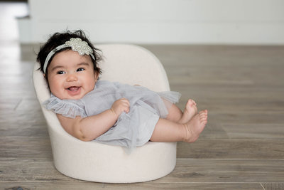 6 month old baby smiling in seat