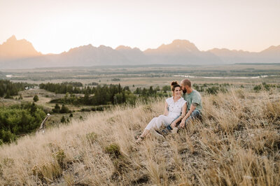 jackson hole engagement photos at sunset with grand teton national park in the background