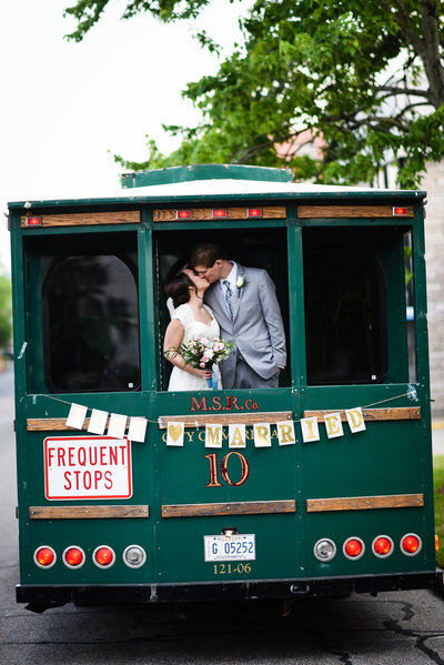 Couple kisses on streetcar at Meridian MS Wedding at Union Station