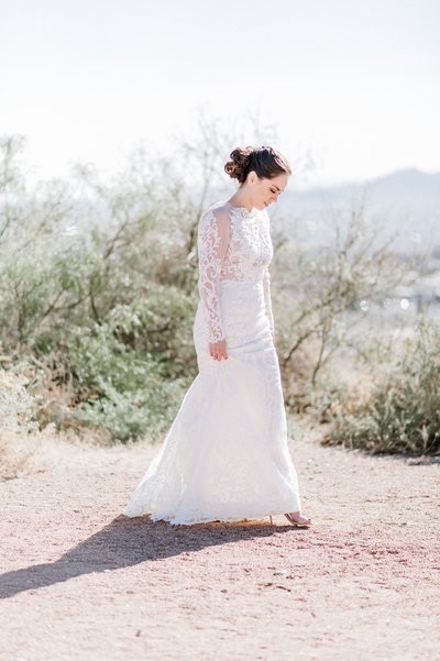 bride walking through desert