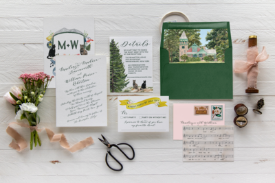 Custom invitation suite with watercolor illustrations, custom crest, and sheet music