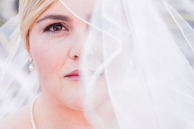 Closeup creative bridal portrait with veil by C. elyse photos
