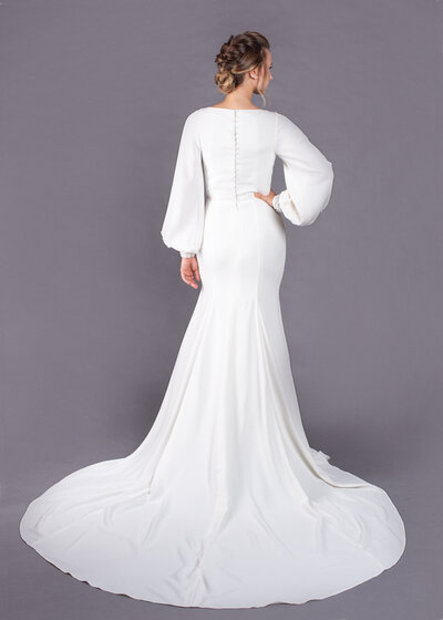 Back view of the Milly wedding dress with its high back