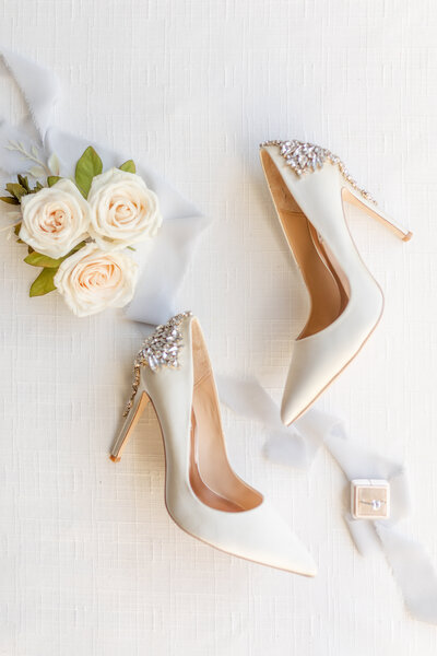 Gorgeous couture bridal wedding shoes that are cream colored wedding heels with beading on the heels