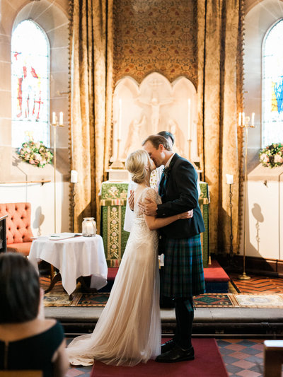 First Kiss in Chapel at Cromlix Hotel in Scotland