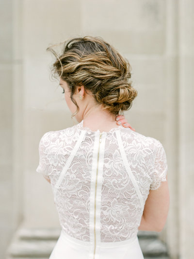 Bride in short sleeve lace dress with elegant updo