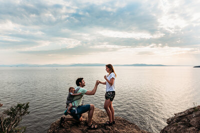 man proposing to woman next to water