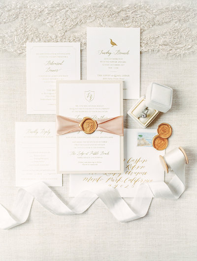 Letterpress wedding invitations with up close ring detail from a winery wedding in Temecula, California