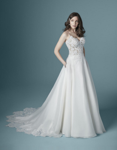 A-Line Wedding Dress. This A-line wedding dress is lovely and romantic. You'll be dizzy with compliments on the train—an illusion lace hemline cut in the shape of a dahlia.
