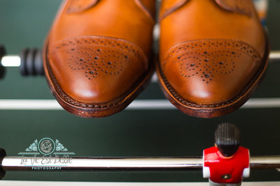 wedding day details, grooms shoes on foosball table