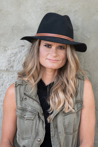 personal brand headshot of woman wearing black hat