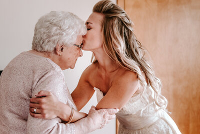 bride kissing grandmother on forehead