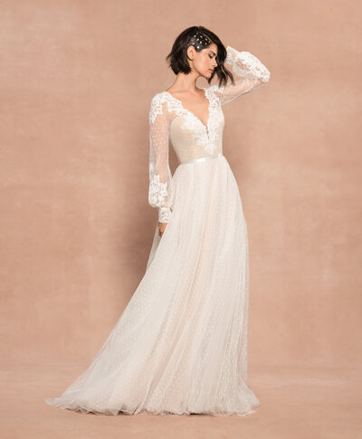 Blush by Hayley Paige bridal gown - Ivory swiss dip-and-dot A-line gown with cashmere lining, curved V-neck bodice and dream catcher sleeves with lace appliqué, open back and ribbon trim at the natural waist.