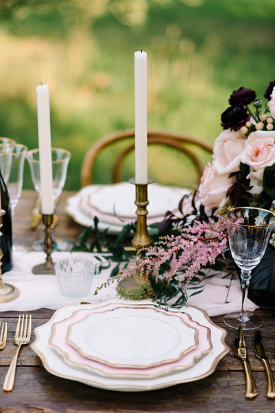 Brass candlectick holders on wedding table