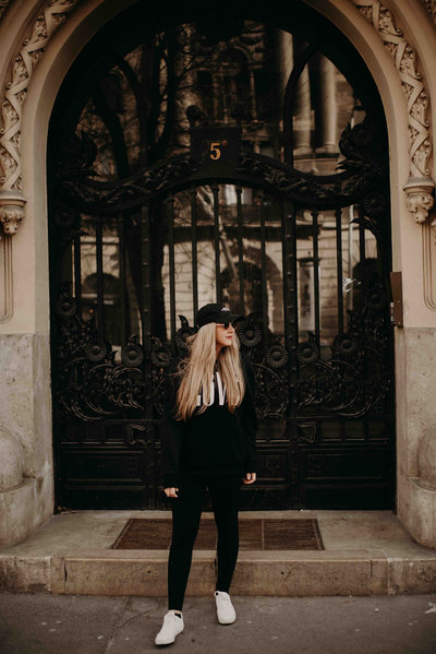 Girl standing in front of door