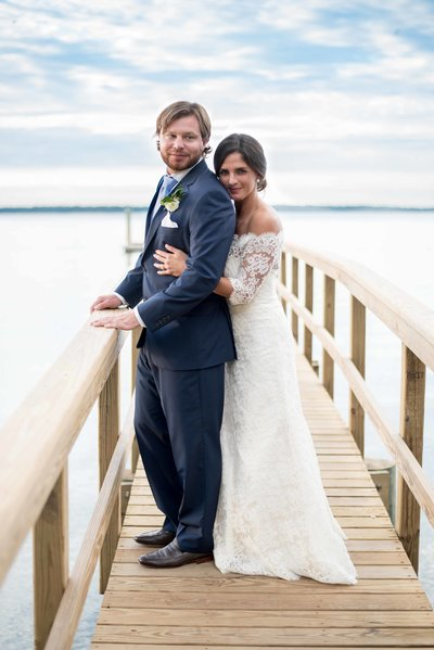 Bride and groom on dock after wedding on Hilton Head, SC
