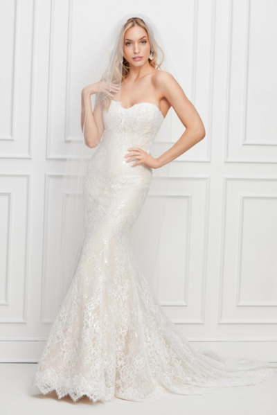 Get ready to wrap your curves in a beaded column of Cherie lace. Finished with a cathedral train, it's the right thing to wear when it's your time to shine.