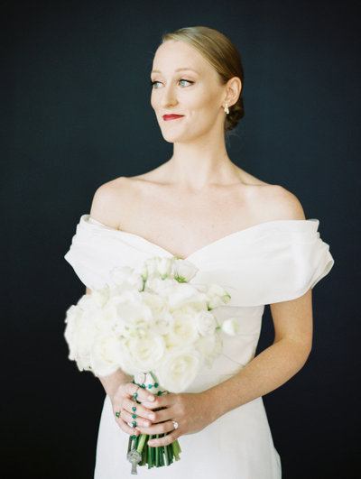 bride with red lipstick wearing a carolina herrera wedding gown