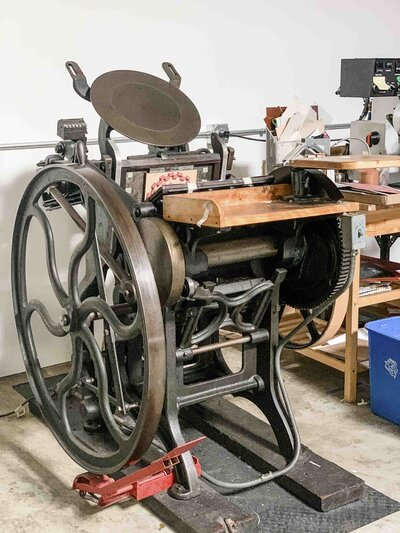 Vintage printing press at Copper Willow Paper Studio