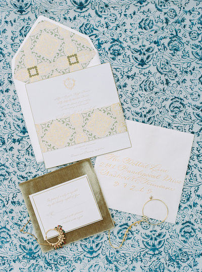 Custom blue and gold wedding stationary in Nashville
